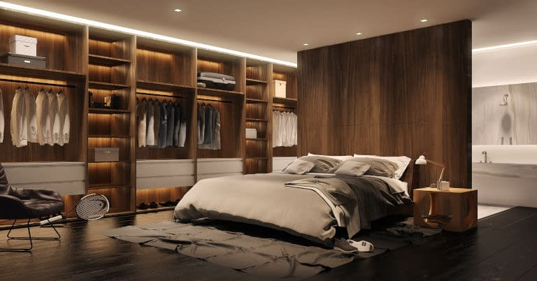 A bedroom and closet with some clutter.