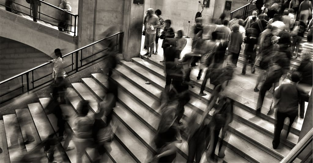 Busy, high stress people on stairs.