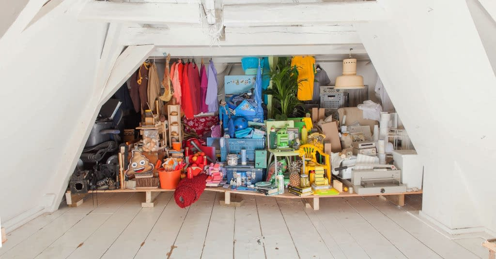 An organized pile of clutter in a basement.