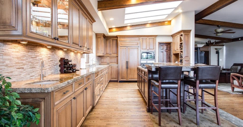 A decluttered classy wood kitchen with lots of clutter storage.