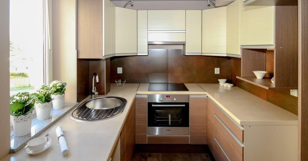 A decluttered, sleek, older minimalist kitchen with no clutter.