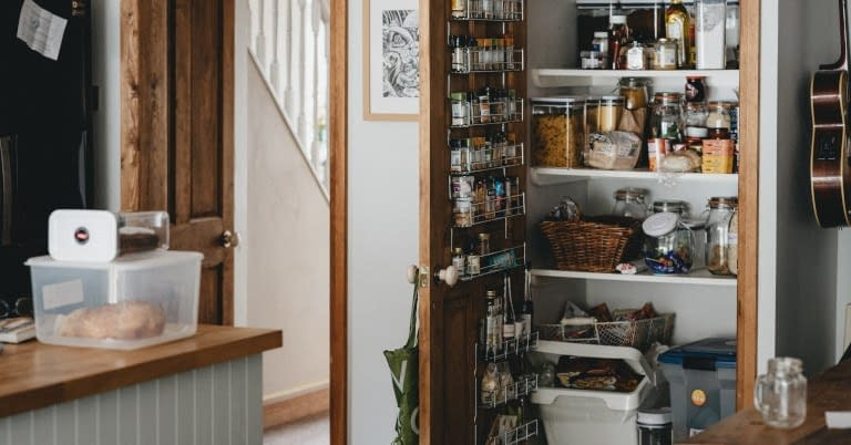 A kitchen pantry with clutter.