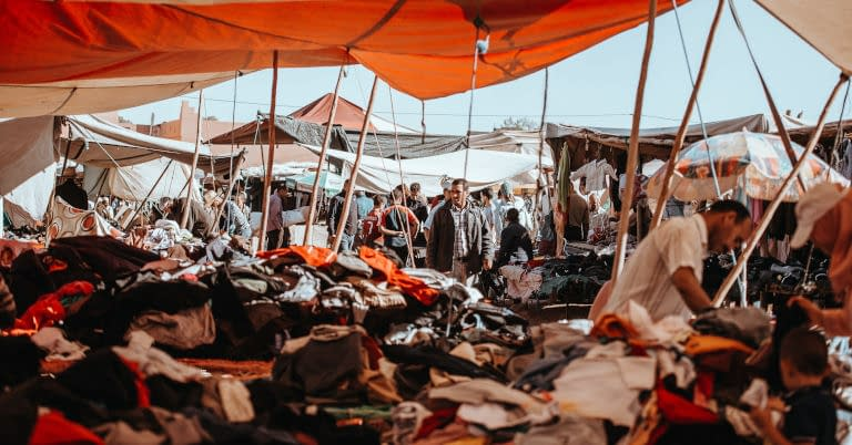 An outdoor used clothes market in Morocco.