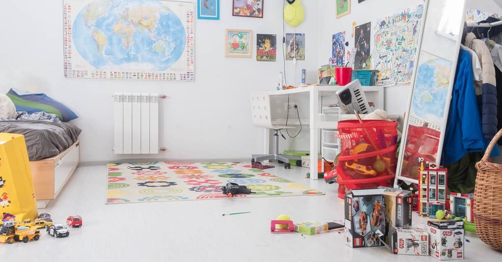 A cluttered kids toy room.